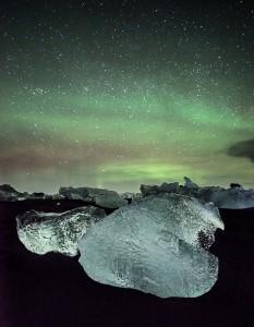 The aurora lights up the sky over standed icebergs near Jokulsarlon